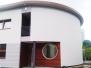Elewacje drewniane - elewacja Meranti okrągłe okno